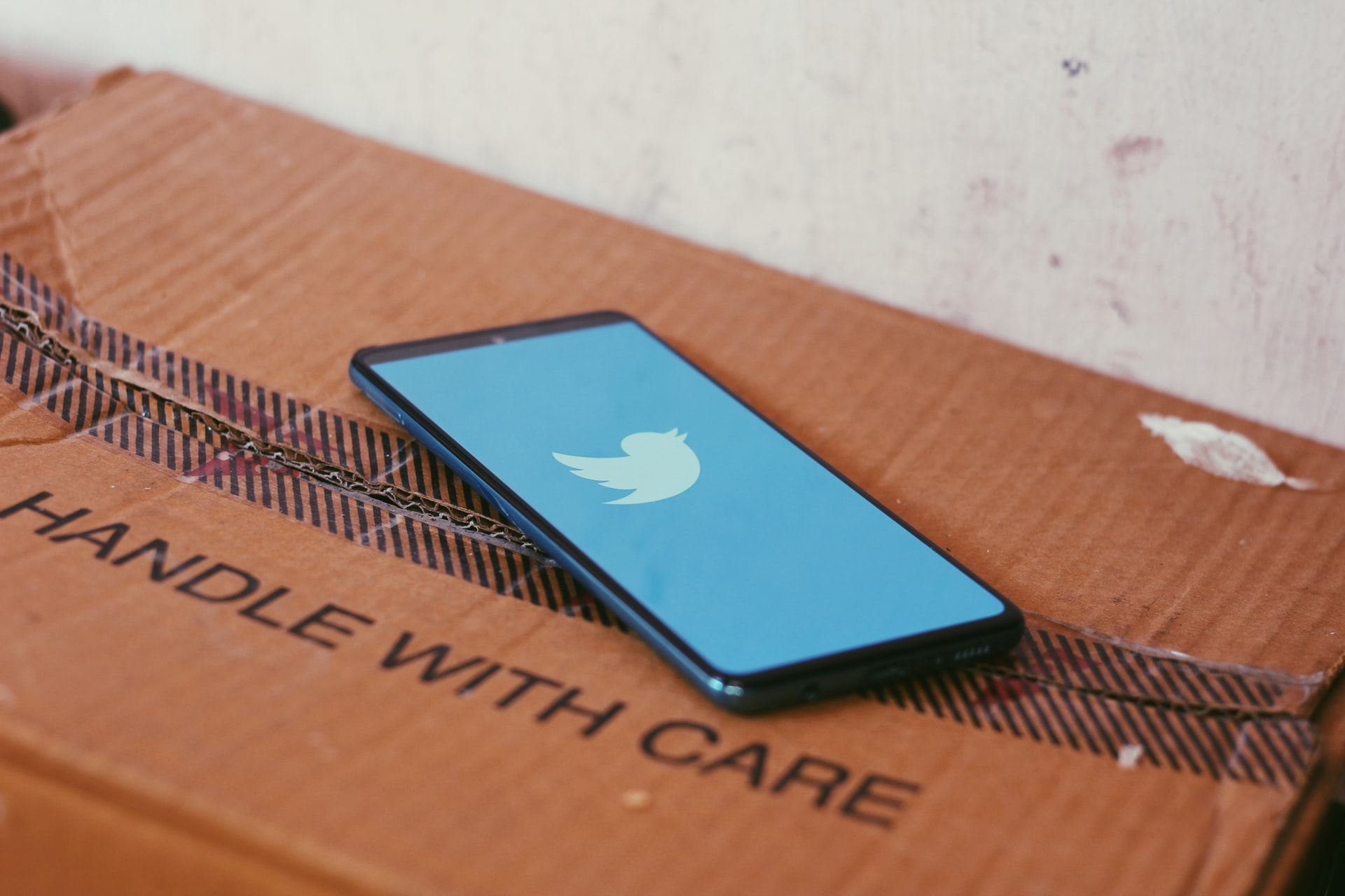 Twitter - Handle with car; Photo by Ravi Sharma on Unsplash